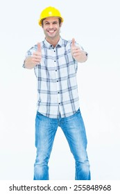 Portrait of happy male architect gesturing thumbs up sign over white background