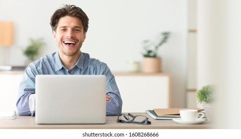 Portrait Of Happy Male Employee Smiling At Camera While Working On Laptop In Office, Wide Long Horizontal Banner, Panorama With Free Space