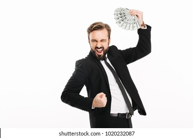 Portrait of happy male entrepreneur rejoicing his prize and holding fan of money 100 dollar bills isolated over white background