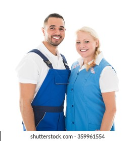 Portrait of happy male and female janitors standing isolated over white background