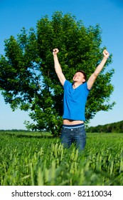 portrait of happy man against tree and blue sky