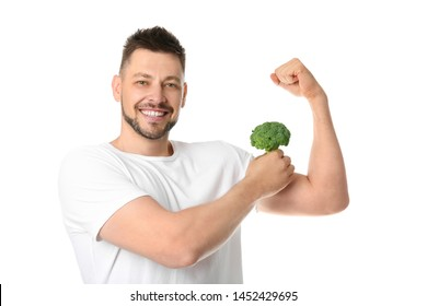Portrait of happy man with broccoli on white background