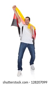 Portrait Of A Happy Man Holding An German Flag. Isolated on white