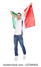 Portrait Of A Happy Man Holding An Italian Flag. Isolated on white