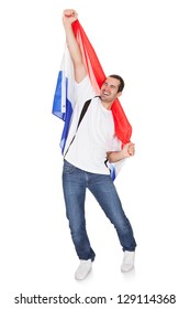 Portrait Of A Happy Man Holding An Netherlands Flag. Isolated on white