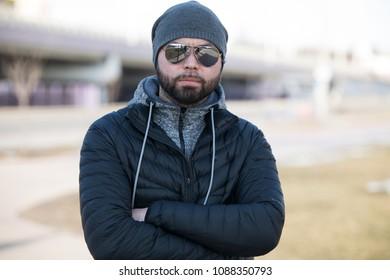 Portrait of happy man outdoor.