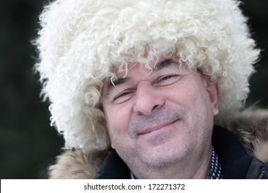 Portrait of happy man in papakha outdoor in winter