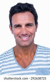 Portrait of happy man smiling at camera on white background