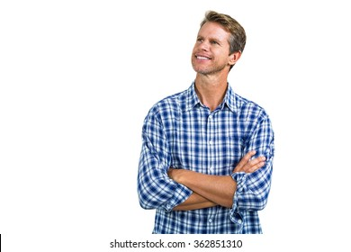 Portrait of happy man standing against white background