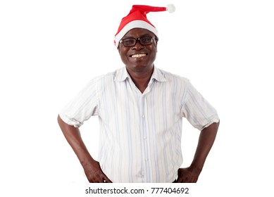 portrait of a happy man standing hands at the hip, with a Santa Claus hat isolated on a white background.