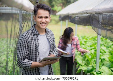 portrait of happy man with tablet in modern hydrophonic farm