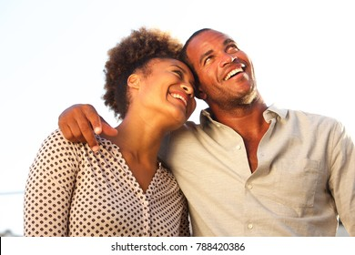 Portrait of happy man and woman standing together on date