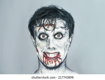 Portrait of happy man with zombie face art. Halloween or horror theme