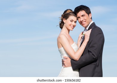 Portrait Of Happy Married Young Couple Outdoor With Copyspace