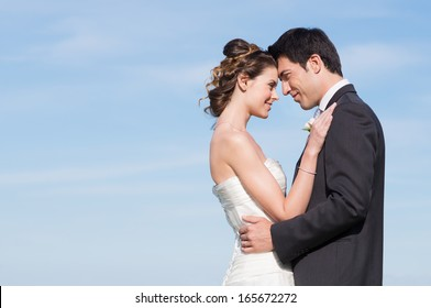 Portrait Of Happy Married Young Couple Outdoor