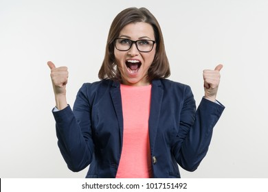 Portrait of happy mature businesswoman with thumbs up. White Background Studio.