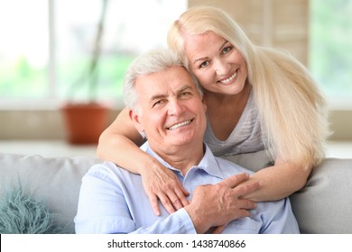 Portrait of happy mature couple at home