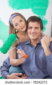 Portrait of happy mature couple looking at camera and smiling