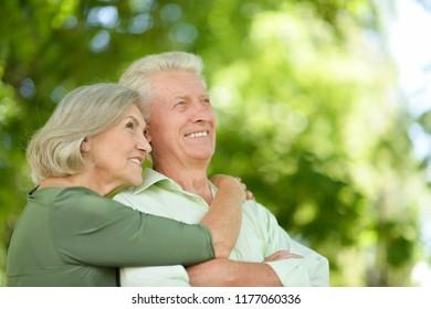 Portrait of happy mature couple in park