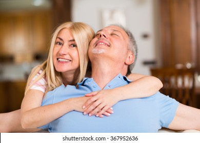 Portrait of an happy mature couple talking in their home