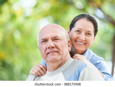 Portrait of happy mature couple together in autumn park