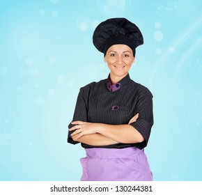 Portrait Of Happy Mature Female Chef With Arm Crossed
