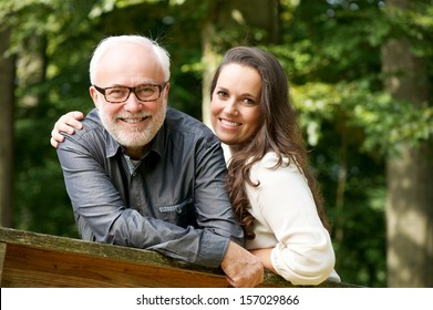 Portrait of a happy mature man smiling with young woman