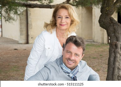 Portrait of happy mature man and woman outdoor