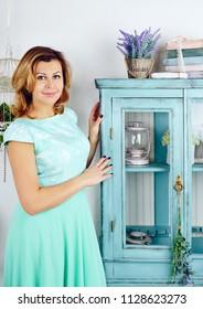 Portrait of happy mid adult woman wearing blue dress