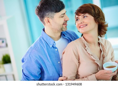 Portrait of happy middle aged couple looking at one another