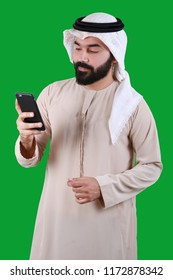 Portrait Of A Happy Middle Eastern Man Wearing UAE Traditional Dress -  Using Mobile Phone Technology