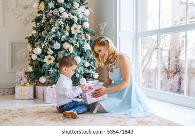 portrait of a happy mother and baby celebrating Christmas,elegant interior Christmas