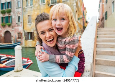 Portrait of happy mother and baby girl in venice, italy
