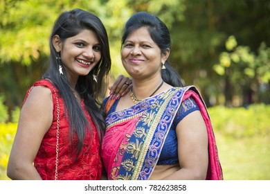 Portrait of happy mother and daughter embracing, Smiley mother and daughter at outdoor.
