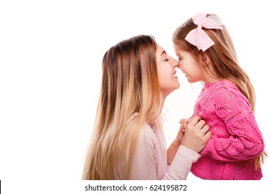 Portrait of happy mother and daughter isolated on white. Daughter kissing mother. Happy family. Happy mother's day. Mothers day card.