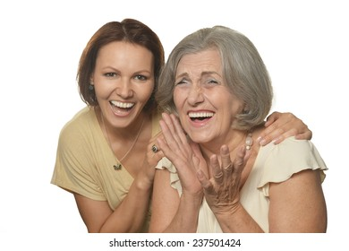 Portrait of a happy mother and daughter on white