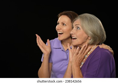 Portrait of a happy mother and daughter surprised