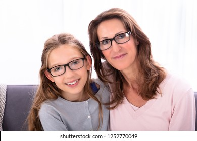 Portrait Of Happy Mother And Daughter Wearing Eyeglasses