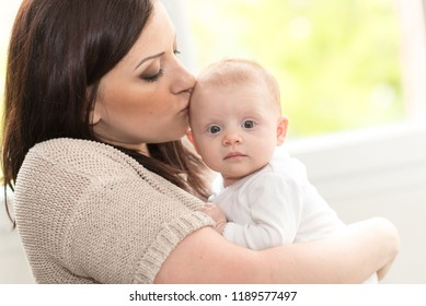 Portrait of happy mother with her cute baby girl