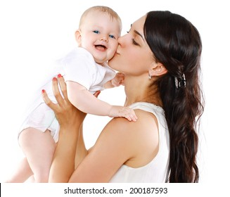 Portrait happy mother holds and kissing her baby