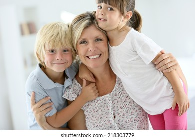 Portrait of happy mother with kids
