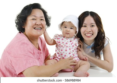 Portrait of happy multi generations Asian family, grandmother, mother and grandchild, isolated on white background.