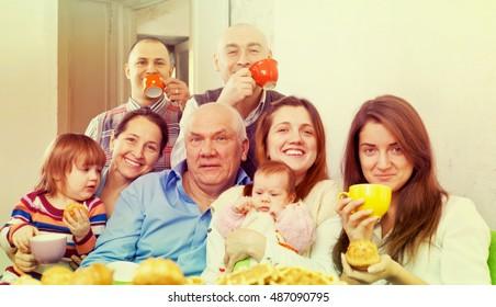 Portrait of happy multigeneration family having tea at home