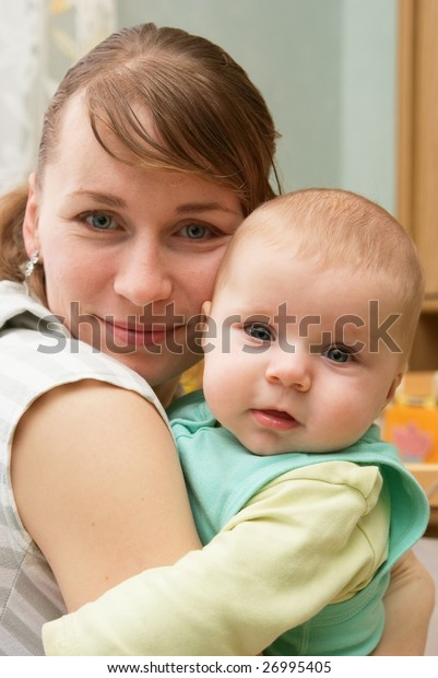 Portrait of happy newborn baby and mother