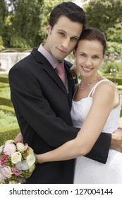 Portrait of a happy newlywed couple embracing