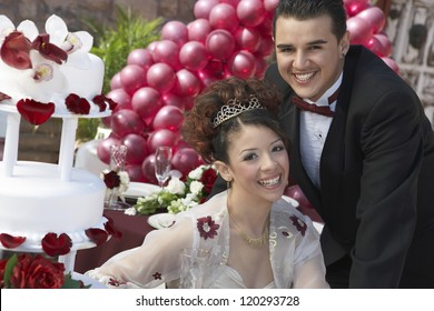 Portrait of a happy newlyweds smiling together on wedding day