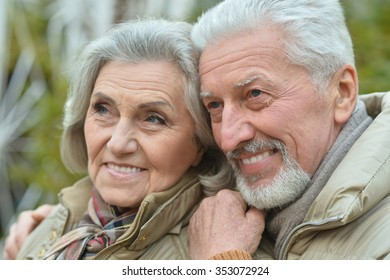 Portrait of a happy nice mature couple walking
