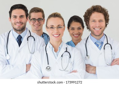 Portrait of happy nurses and doctors in hospital