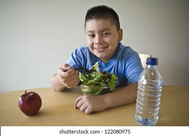 Portrait of a happy obese boy on a diet