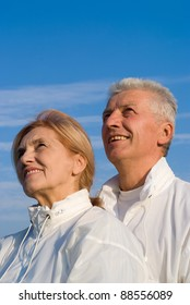 portrait of a happy old couple at sky
